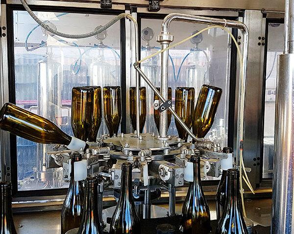 Enotech Imbottigliamento mobile risciacquo bottiglie